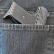 Jeans pocket with pistol — Stock Photo