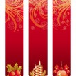 Three red Christmas banners with holiday symbols — Vettoriali Stock