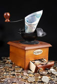 Monetary grinder — Stock Photo