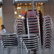 Stacked chairs and tables — Stock Photo