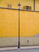Lamp yellow wall street parma — Stock Photo