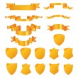 Golden shields and ribbons — Stockvector #1858570