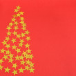 Christmas red background with gold stars — Stock Photo