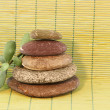 Pebble stack on wicker background — Stock Photo