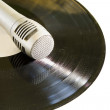 Stock Photo: Old disk with microphone