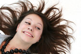 Woman smiling on the floor with her hair — Stock Photo