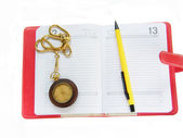 Pensil and watch over note pad — Stock Photo