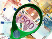 Magnifying and European Union Currency — Stock Photo