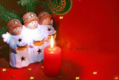 Christmas angels with candle and book — Stock Photo
