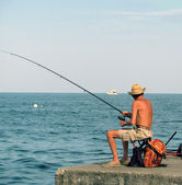 Old fisherman — Stock Photo