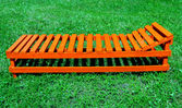 Orange wooden plank bed — Stock Photo