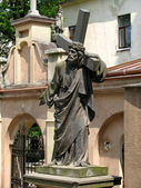 Jesus Christ statue with cross — Stok fotoğraf