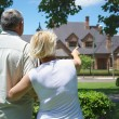 Stock Photo: Man and woman looking a house