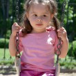 Little girl on a swing — Stok fotoğraf