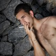 Stock Photo: Guy with cigarette
