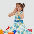 Girl sitting on a rug with lego — Stock Photo