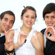Three friends on the fingers show the date — Stock Photo