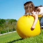 Girl play with yellow ball — Stock Photo