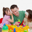Daughters plaing with father — Stock Photo
