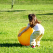 Stock Photo: Little girl play with yellow ball