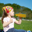 Little girl drinking juice — Stock Photo