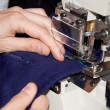 Sew on a sewing machine — Photo