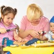 Teacher and Two children are working tools — Stock Photo