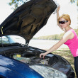 Beautiful girl repairing the car  — Stock Photo