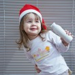 Girl with bottle and in Santa Claus hat — Stock Photo
