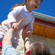 Father tossing up his daughter — ストック写真 #1508526