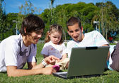 Two guys and a little girl in the park — Stock Photo