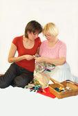 Women embroider — Stock Photo
