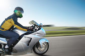 Racer on motorcycles riding on the expressway are — Stock Photo