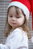Ittle girl in a Santa Claus hat — Stock Photo