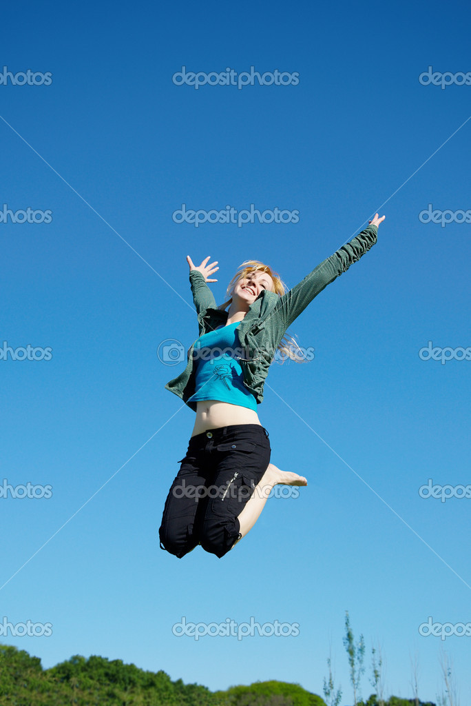Beautiful girl jumping in the park no sky backgroound — Stock Photo #1507998