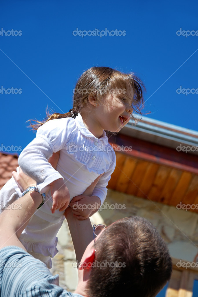 Father tossing up his beautiful daughter on the sky background — Stock Photo #1508533