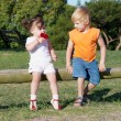 Boy and a girl in the park — Stok fotoğraf