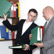 Businessmen gets a folder - Stock Photo