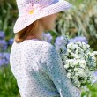Stock Photo: Girl in the hat with flowers