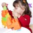 Little girl plays colorful cubes — Stok Fotoğraf #1515685