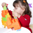Foto de Stock  : Little girl plays colorful cubes