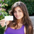 Beautiful girl with business card — Stock Photo #1530761