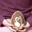 Little girl holding an Easter egg - Stock Photo