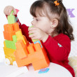 Girl plays a colorful cubes — Stock Photo