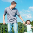 Young girl played with father — Stock Photo