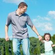 Young girl played with father — Stock Photo #1531128