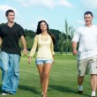 Three friends go to the park — Stock Photo