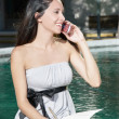 Beautiful girl talking on a mobile phone — Stock Photo