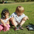 Boy and a girl with laptop in the park — Photo
