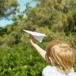 Boy launch paper airplane — Stock Photo #1533575